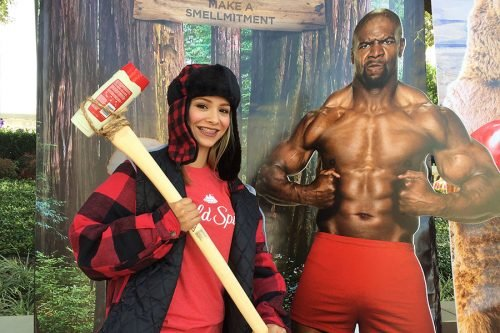 old spice campus event - girl holding deodorant axe next to cardboard cutout